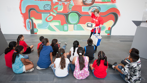 A docent introduces kids to art from ancient Mexico