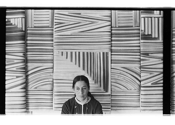 Hurtado in front of Self Portrait in progress, 1973