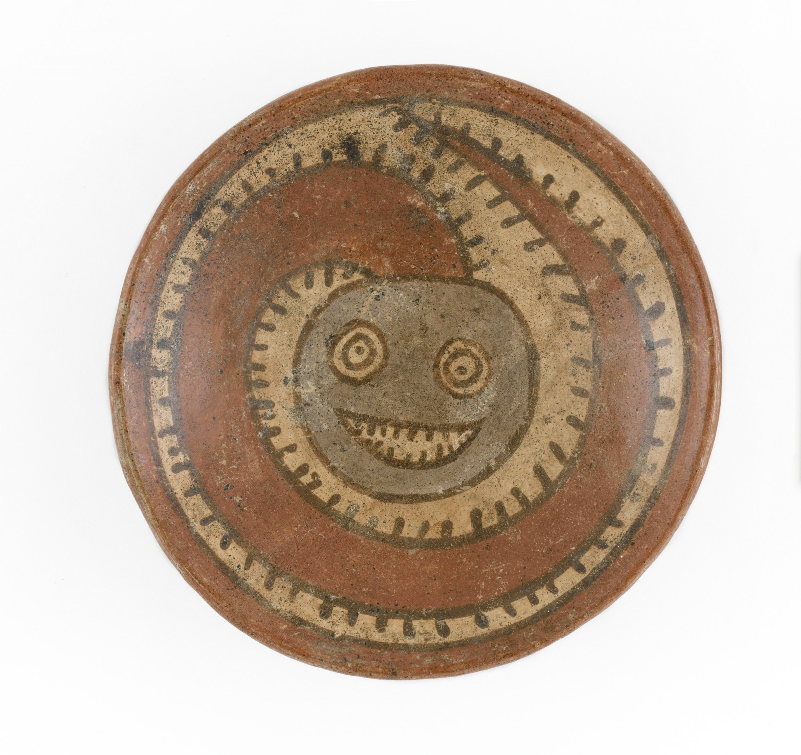 Image: Plate with Smiling Serpent, Millipede, or Tadpole Creature, Panama, Conte Style, 600–800 CE